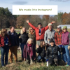 """We made it to Instagram!"" text overlays a photo of the Land For Good team gathered in the early spring"